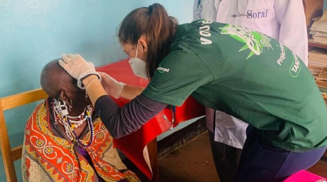 A medical volunteer does a basic health check under the supervision of a local doctor in Tanzania.
